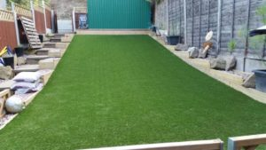 artificial grass installed on a sloped garden