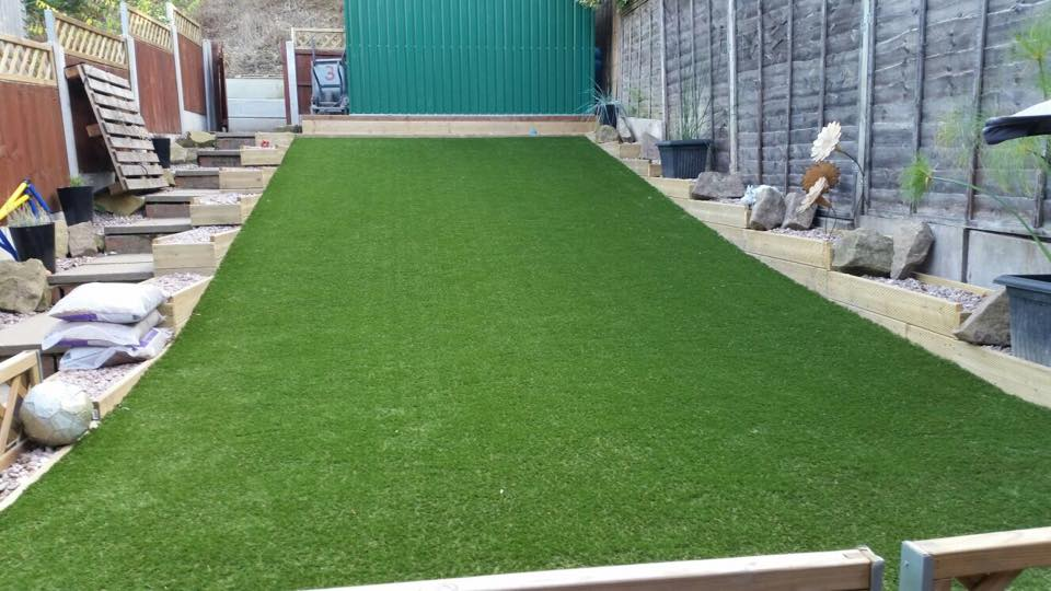 artificial grass installed on a sloped garden